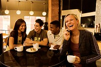 Teens hanging out in coffee shop