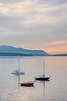 Three sailboats anchored in Bellingham Bay, Lummi Island is in the distance, Bellingham Washington USA