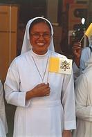 Myanmar (Burma) - Mandalay. Nun holding a flag