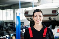 portrait of female mechanic in garage