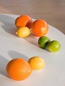 Limes, citruses and oranges on table