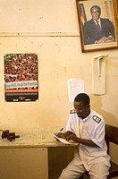 A male nurse takes a moment to complete patinet information at the Outpatient Ward of the the Howard Mission Hospital in Zimbabwe