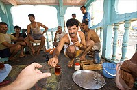 Dubai, Iranian sailors on board of their ship in the Dubai Creek