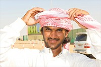 Dubai, demonstration of how to attach a headscarf