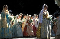 Valencia, women and girls in traditional costumes in the procession to the Plaza de la Virgen with a floral offering to Our Lady of the Abandoned or N...