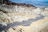 Badland erosion, in Death Valley, California, USA. The erosive pattern seen here is typical for deposits of shale, rhyolite or other soft sediments in...