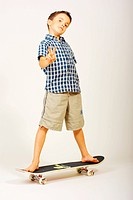 Boy at skateboard, victory sign, cut out