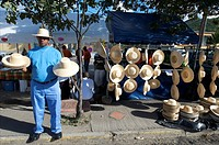 St Martin, man selling hats during the carnival parade