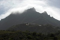 Saba, the church of Hell´s Gate on a rim and Mount Scenery behind