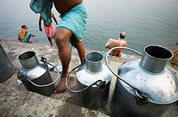 Milk cans on the ghats of Ganges river, Varanasi. Uttar Pradesh, India