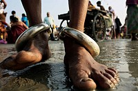 Pilgrims bathing at the confluence of the river Ganges and the Bay of Bengal. Sagar Mela. Ganges River. India.