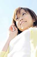 Woman calling by a cell phone