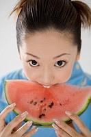 Yukata woman who nibbles a watermelon