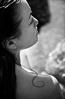 Close up profile of Filipino young nude woman on beach