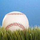 Studio shot of a baseball resting in grass (thumbnail)