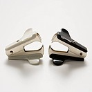 Two staple removers on white background