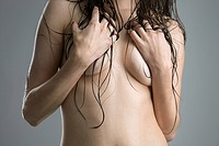 Nude Caucasian woman covering breast with arms (thumbnail)