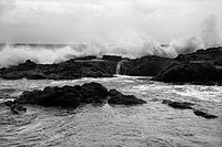 Landscape shot of waves crashing into rocky Hawaii coast