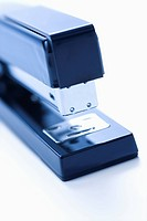 Blue stapler on white background