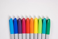 Group of colorful markers lined up in a row (thumbnail)