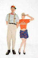 Caucasian young man dressed like nerd wearing propeller hat with blonde Caucasian young woman in... (thumbnail)