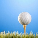 Studio shot of a golfball on a tee in grass