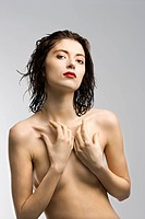 Portrait of attractive nude Caucasian redhead young woman with wet hair