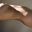 Torso of nude woman arching back