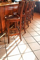 Chairs lined up at bar in nightclub or restaurant