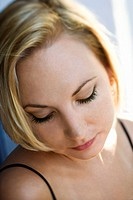 Caucasian mid-adult blonde woman looking down (thumbnail)