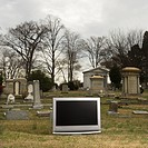 Flat panel television set in cemetary