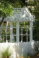 Garden arbor with white picket fence