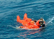 Sailor rescued by a diver after escaping from a submarine