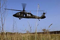 A U.S. Army UH_60 Black Hawk helicopter prepares to pick up the Soldiers