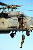 Explosive Ordnance Disposal EOD Technician fast ropes from an SH-60 Seahawk (thumbnail)