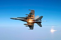 An F/A_18C Hornet aircraft tests its flare countermeasure system