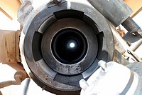 A view looking through the barrel of a M198 155mm Towed Howitzer