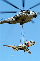 CH_53 Sea Stallion helicopter lifts an unserviceable HU_25 Guardian