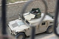 Marine sits in the turret of a Humvee