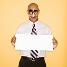 African American man wearing groucho mask disguise holding blank sign