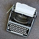Overview of typewriter with paper that has been typed on (thumbnail)