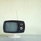Still life of vintage television set with antenna raised