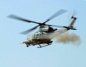 Helicopter launching a pair of 2.75 inch rockets