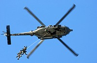 Soldiers conduct a helicopter rope suspension techniques exercise HRST from a SH_60F Seahawk
