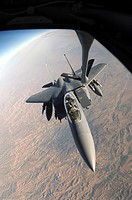 A U.S. Air Force F_15E Strike Eagle aircraft gets refueled by a KC_135T Stratotanker