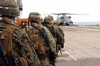 Marines board a CH_53E Super Stallion helicopter