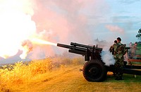 Military Police fire a 105 mm Howitzer