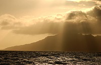Panoramic view of clouds obscuring the sun over the sea, Moorea, Tahiti, French Polynesia, South Pacific