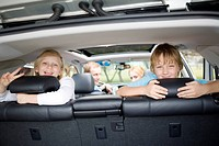 Children in car looking out open rear hatch