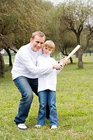 Father teaching his son to bat